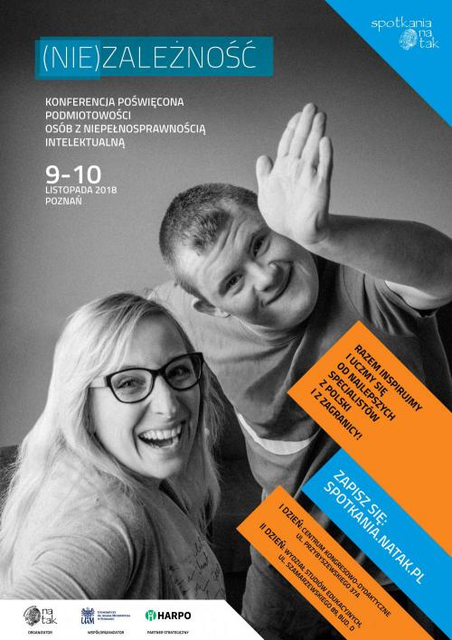 Poster of the conference showing a smiling man and woman