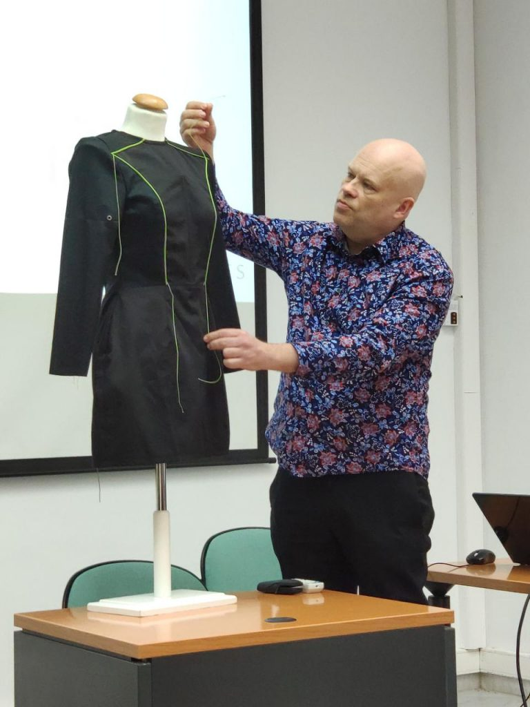 A Swedish project member demonstrating a self-created black dress prototype